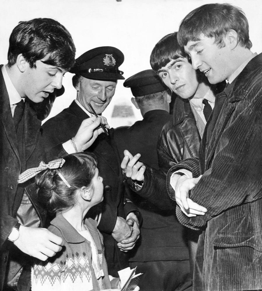 The Beatles, minus Ringo Starr, sign autographs at Speke Airport before flying to Jersey, August 1963
