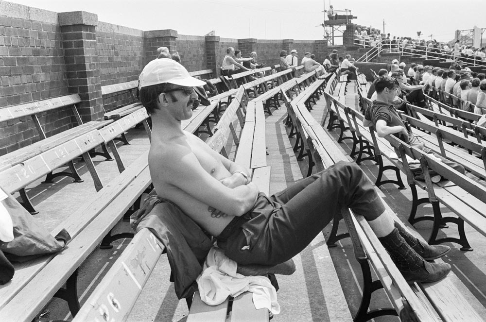 A spectator enjoying the sunshine at Old Trafford, June 1969