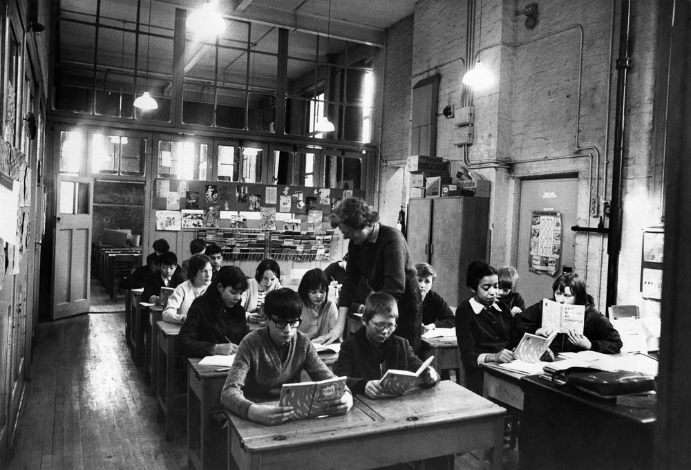 Children read at their desks in a Liverpool classroom, April 1968