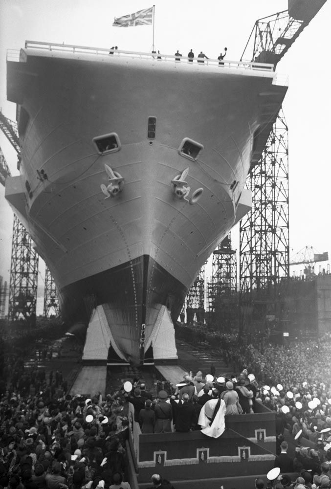 Crowds cheer as HMS Ark Royal is launched at Cammell Laird shipyard, May 1950