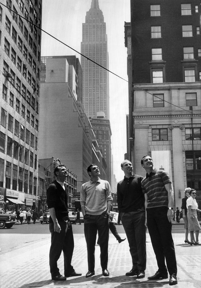 The Empire State building towers behind Liverpool players on their American tour, May 1964