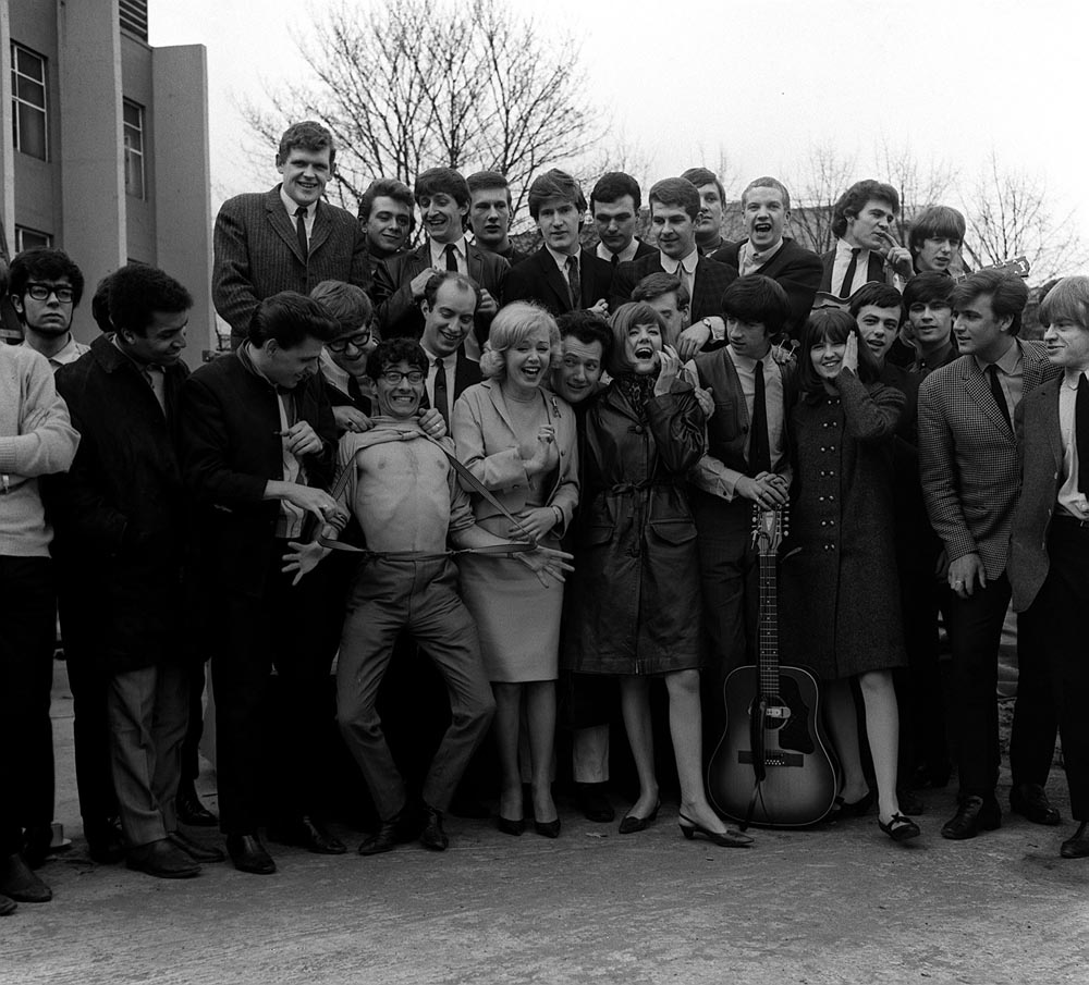 Freddie Garrity loses his shirt with the Fourmost and other artists at the Mod Ball, April 1964