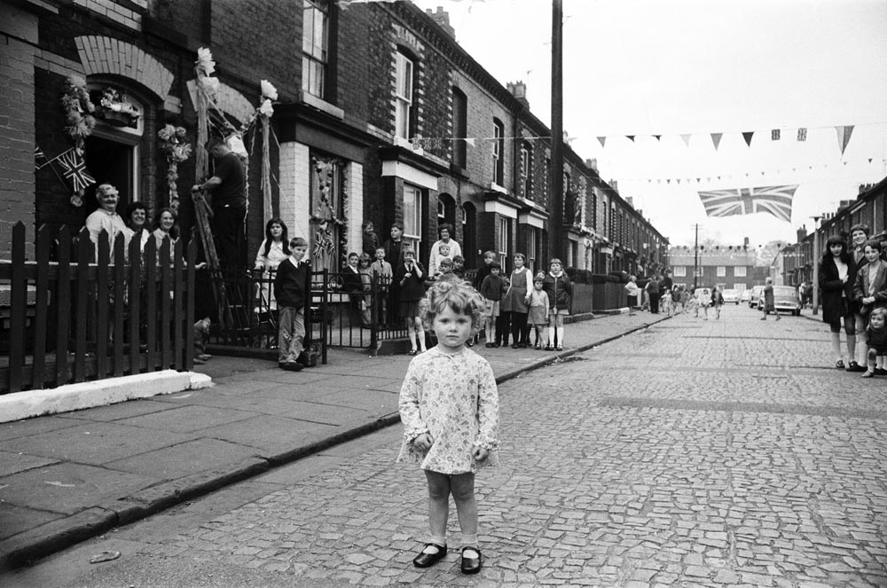 Patricia Dinn, 3, practises welcoming Princess Margaret to Pringle Street, May 1969