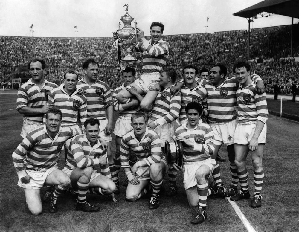 Eric Ashton is held aloft by his Wigan team mates after winning the Challenge Cup, May 1959