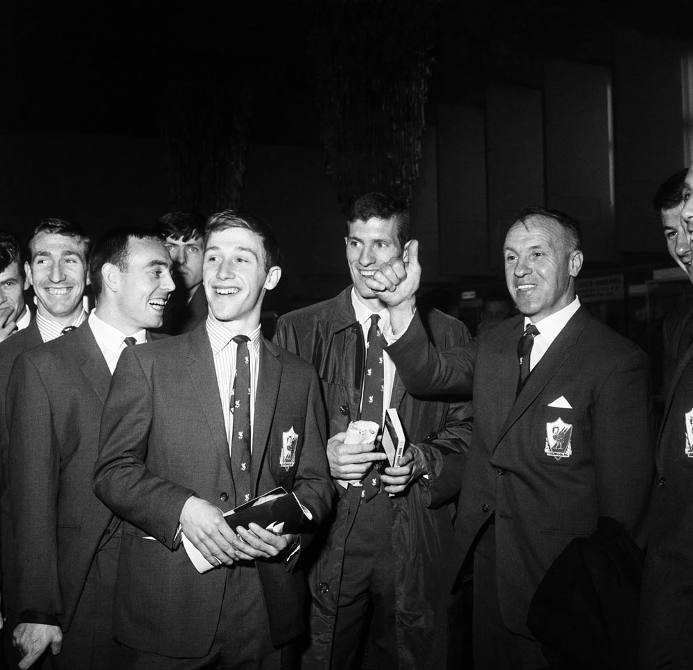 Bill Shankly jokes with players before they fly out on their American tour, May 1964
