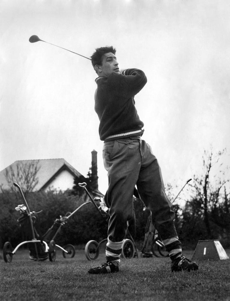 Wigan's Dave Bolton plays golf in rugby boots, May 1963