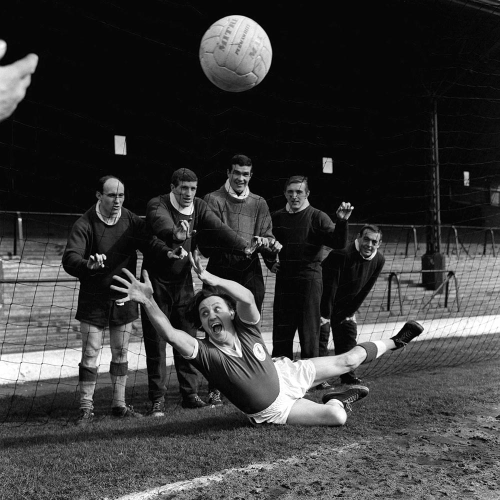 Ken Dodd clowns around in training with the Liverpool team, April 1964