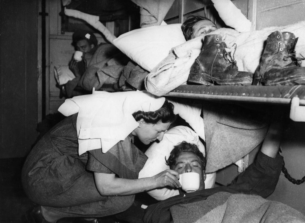 A wounded Manchester soldier aboard a hospital train on D-Day, June 1944