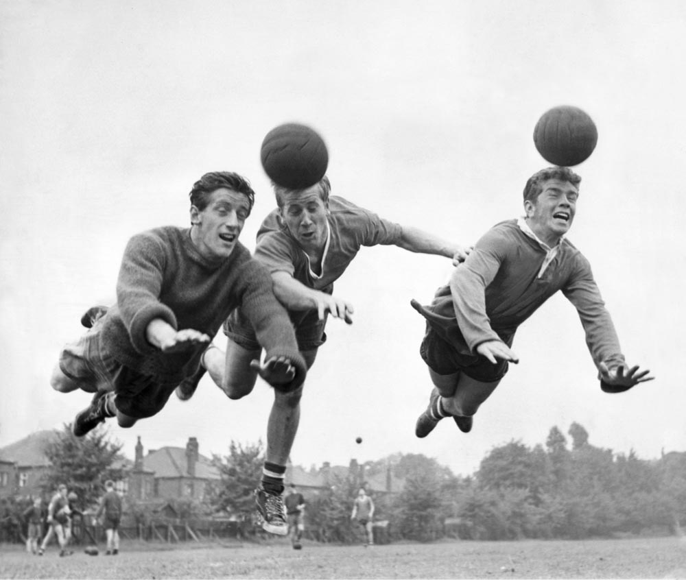 Denis Viollett, Bobby Charlton and Johnny Giles go for the high ball, August 1960