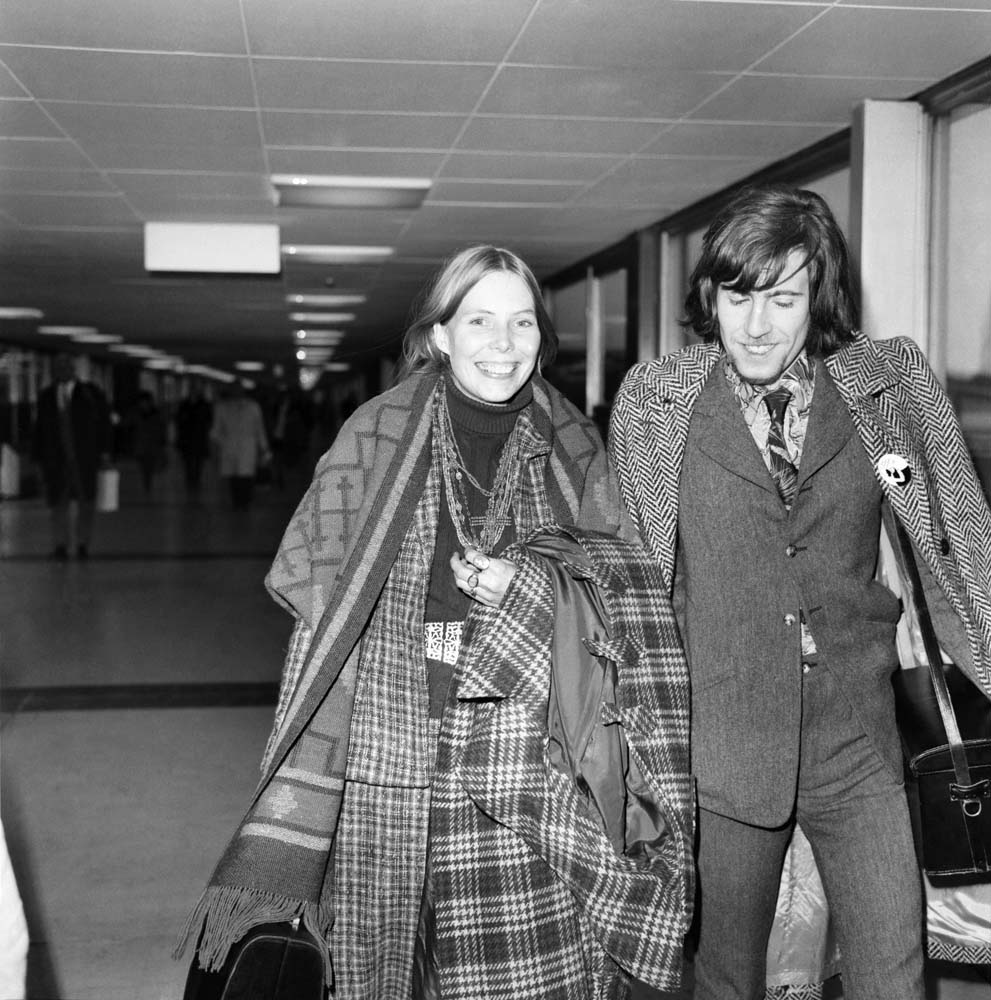 Folk singer Joni Mitchell is welcomed to the UK by Graham Nash, December 1969
