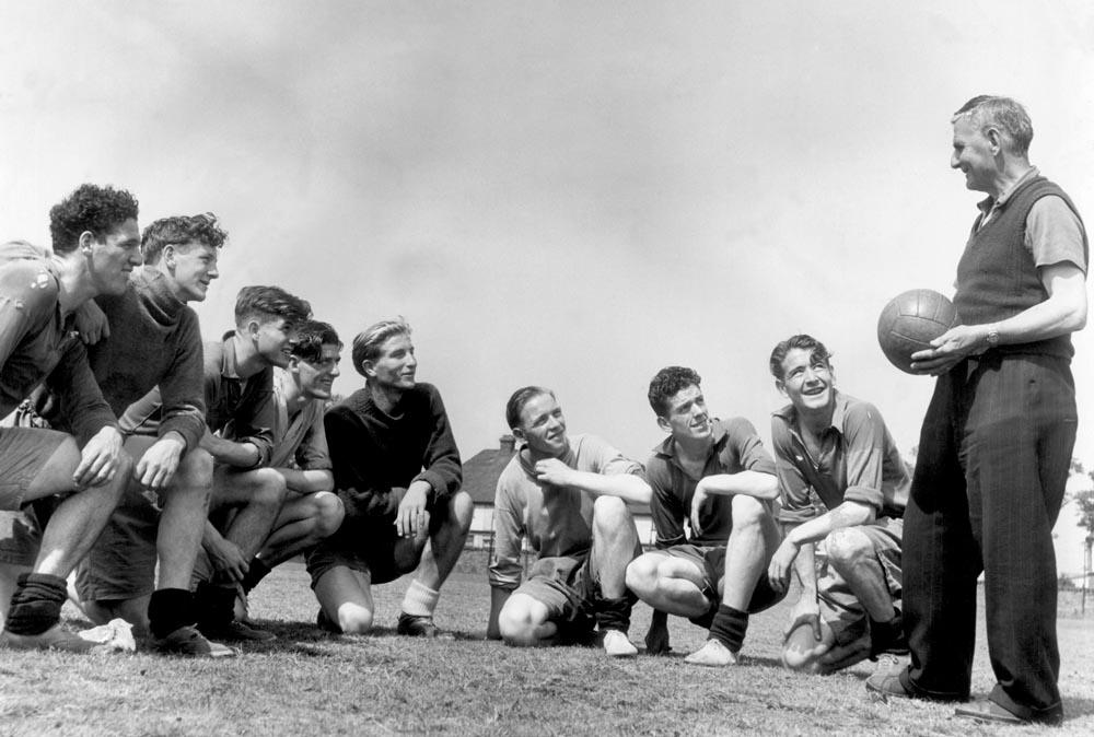 Coach Harry Cooke gets the attention of his Everton players, August 1950