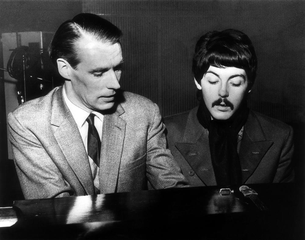 Record producer George Martin at the piano with Paul McCartney, November 1966