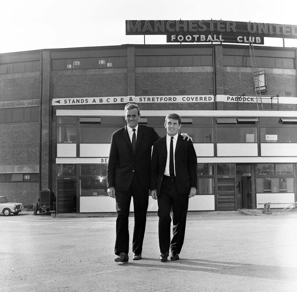 Don Revie, left, signs Johnny Giles from Manchester United, August 1963