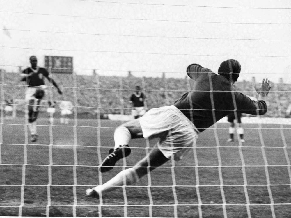Ronnie Moran beats Manchester City 'keeper Bert Trautmann from the penalty spot, August 1962