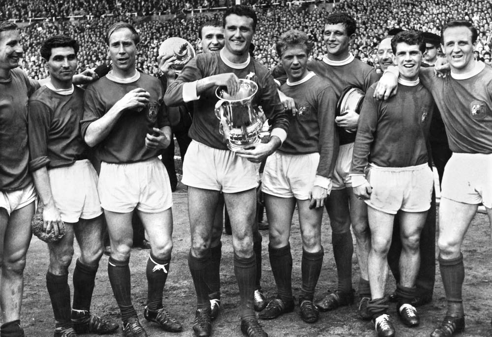Johnny Giles, second right, and United team-mates celebrate winning the FA Cup, May 1963