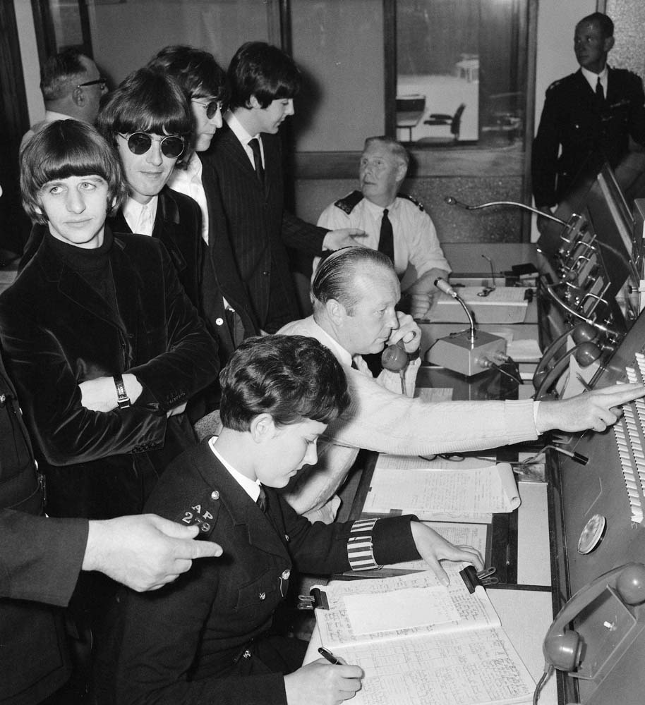 The Beatles tour the Heathrow police control room after their flight is delayed, August 1966