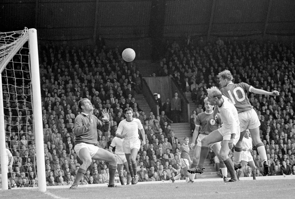 Gordon Wallace heads a rare goal against Arsenal at Anfield, August 1964