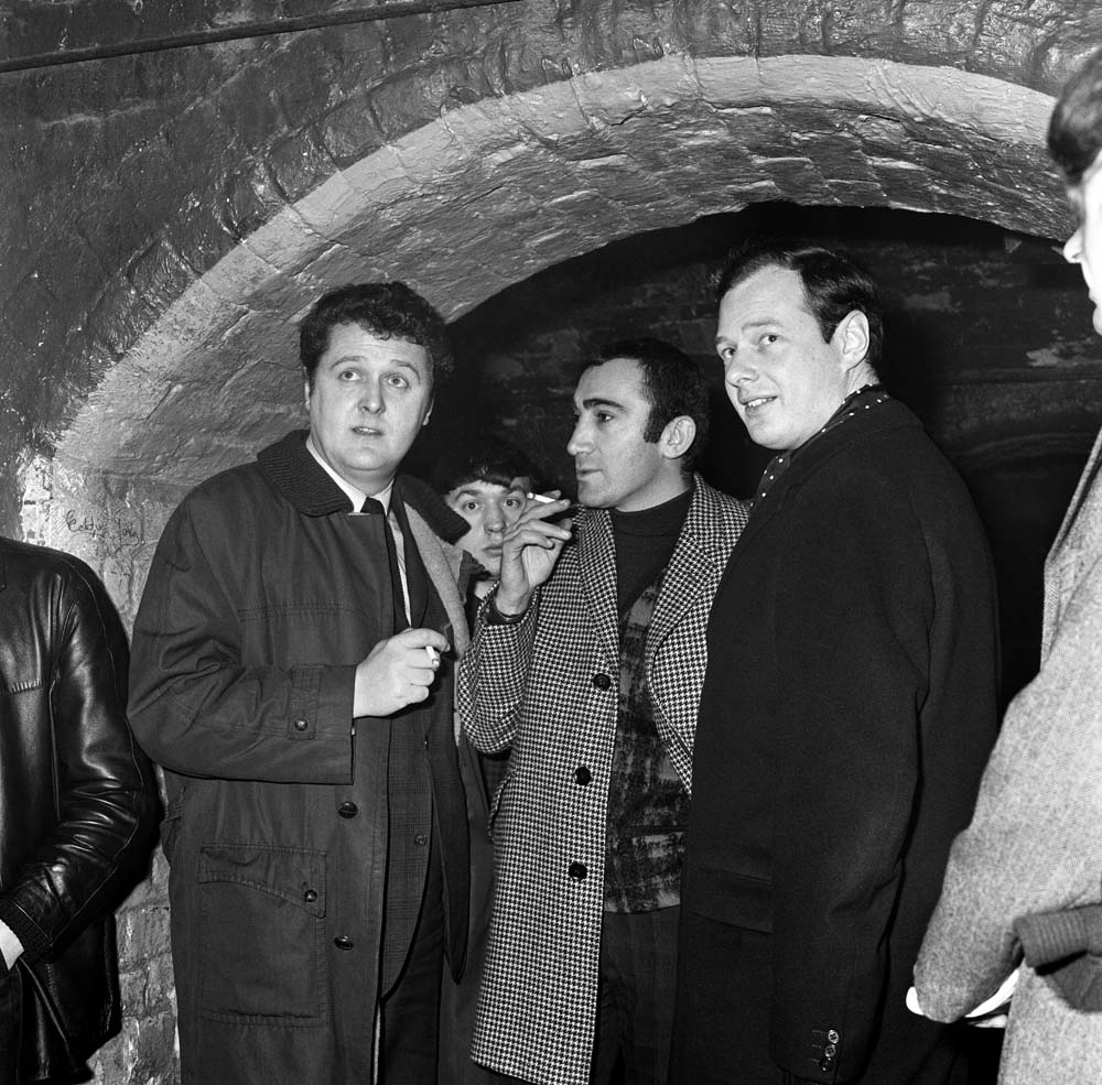 Brian Epstein, right, at the Cavern Club with composer Lionel Bart, centre, January 1964