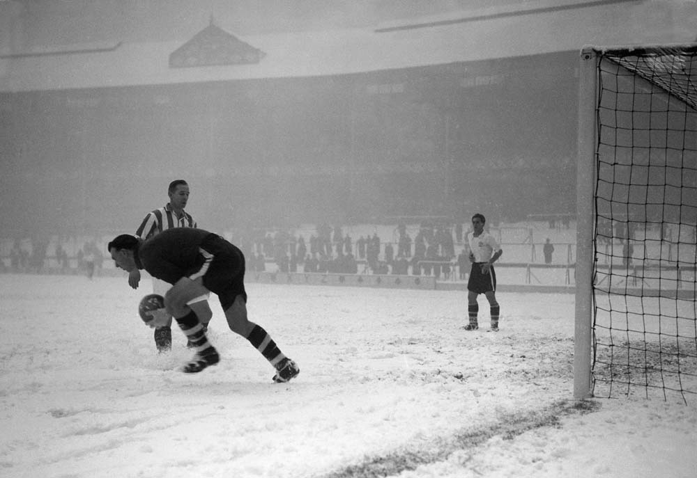 A snowy Goodison Park hosts the FA Cup tie replay between Bury and Stoke, January 1955