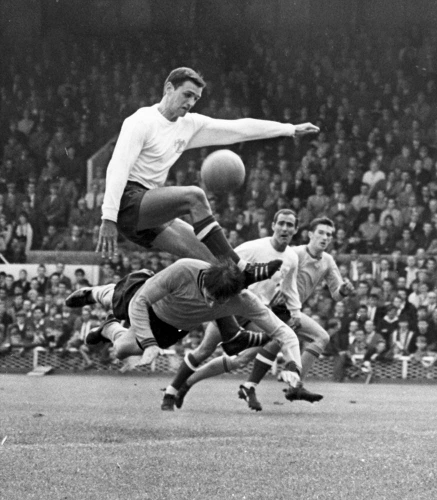 Centre half Eddie Colquhoun wins the ball for Bury against Hull City, August 1966