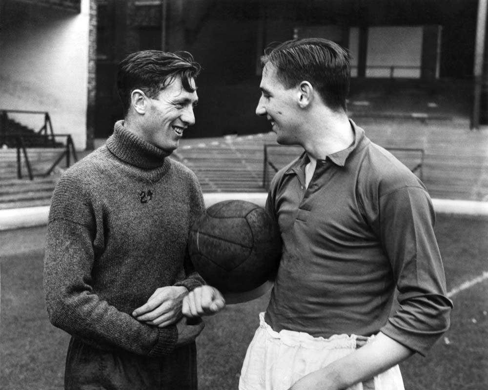 Joe Mercer in his playing days with England team mate Tommy Lawton , April 1939