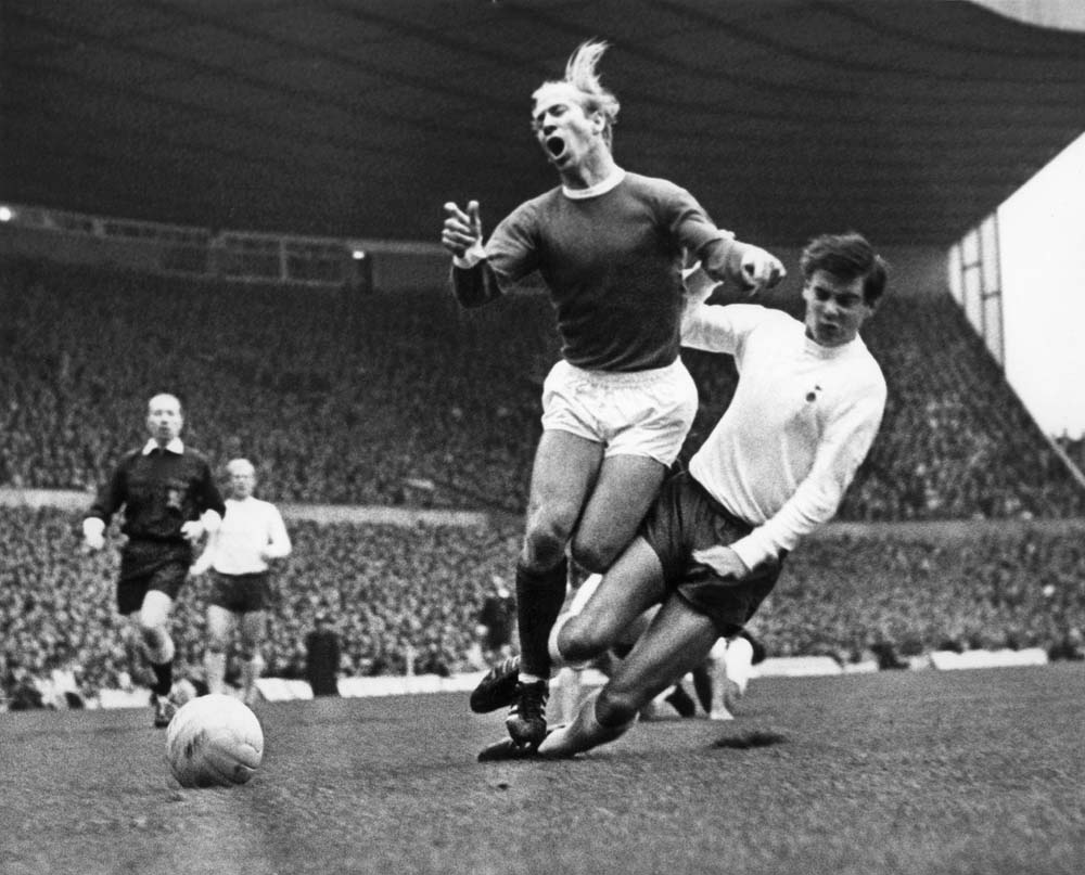Ouch! Bobby Charlton Feels the Pain
