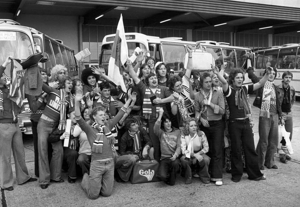 Manchester United fans return home from '77 European game