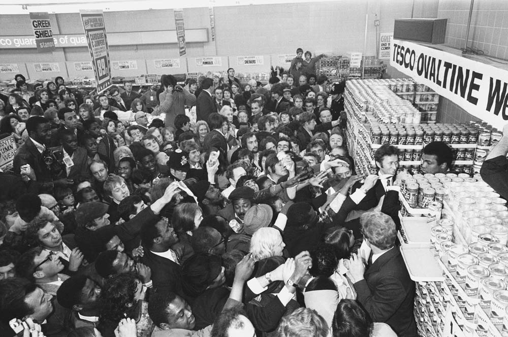Crowds mob Mohammad Ali at a Stretford supermarket, October 1971