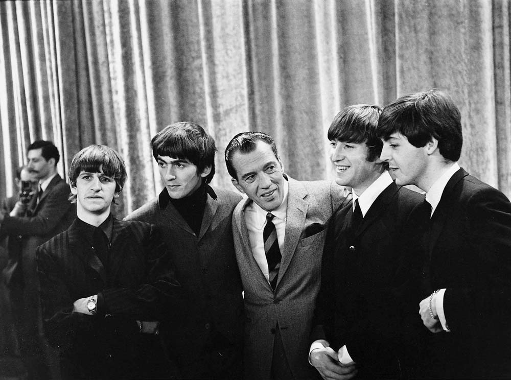 American TV show host Ed Sullivan with the Beatles, February 1964