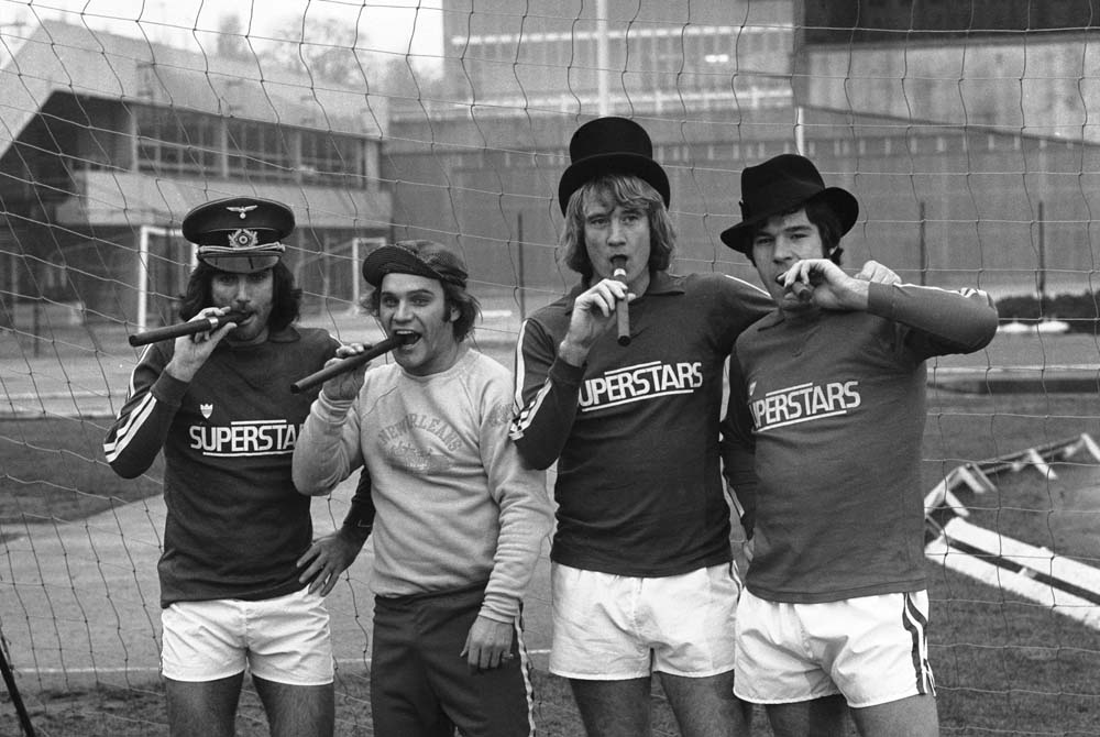 Freddie Starr, second left, sends up Superstars with George Best, Rodney Marsh and Malcolm Macdonald, December 1976