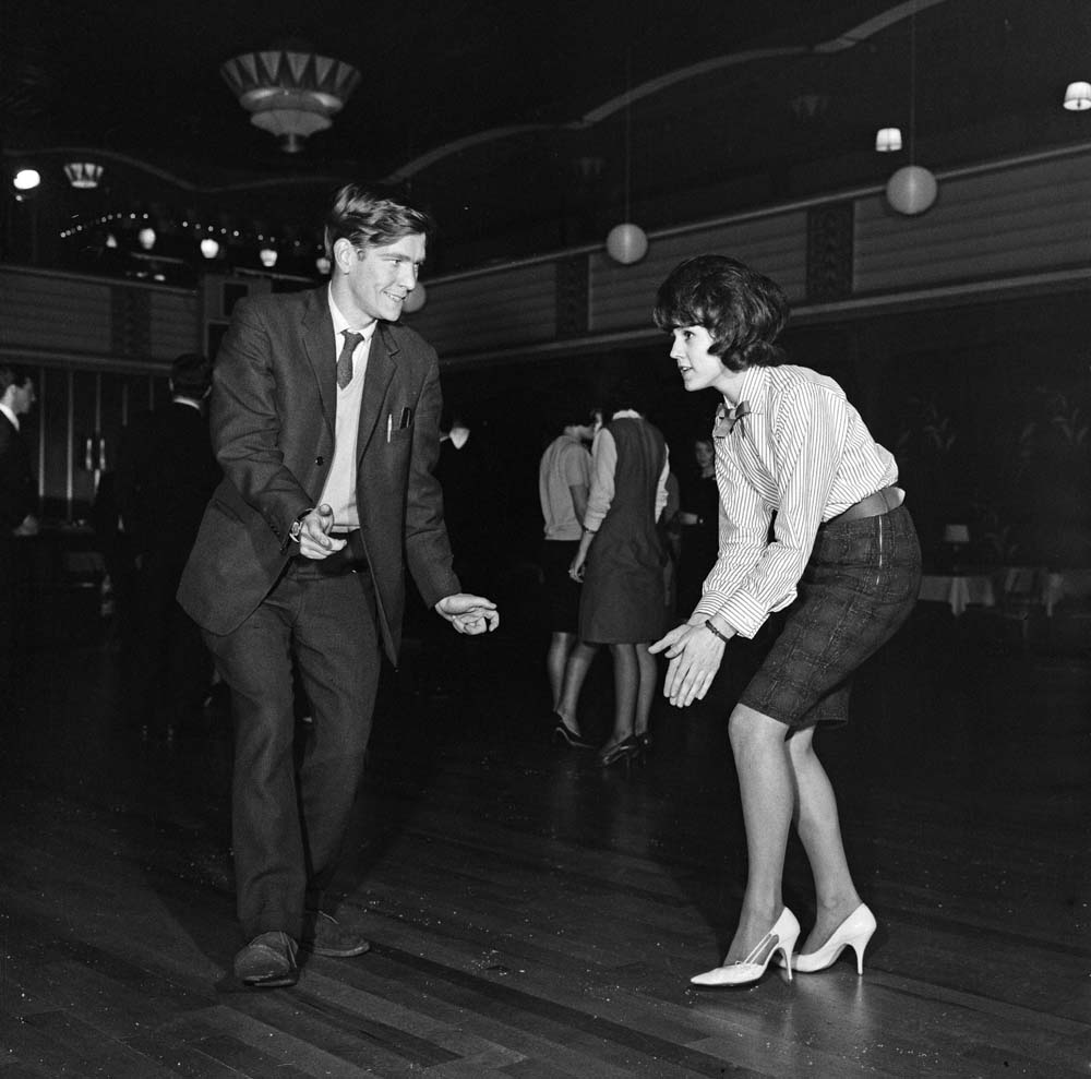 Student Yvonne Smith dances with Tom Courtenay during the filming of Billy Liar in Manchester, November 1962