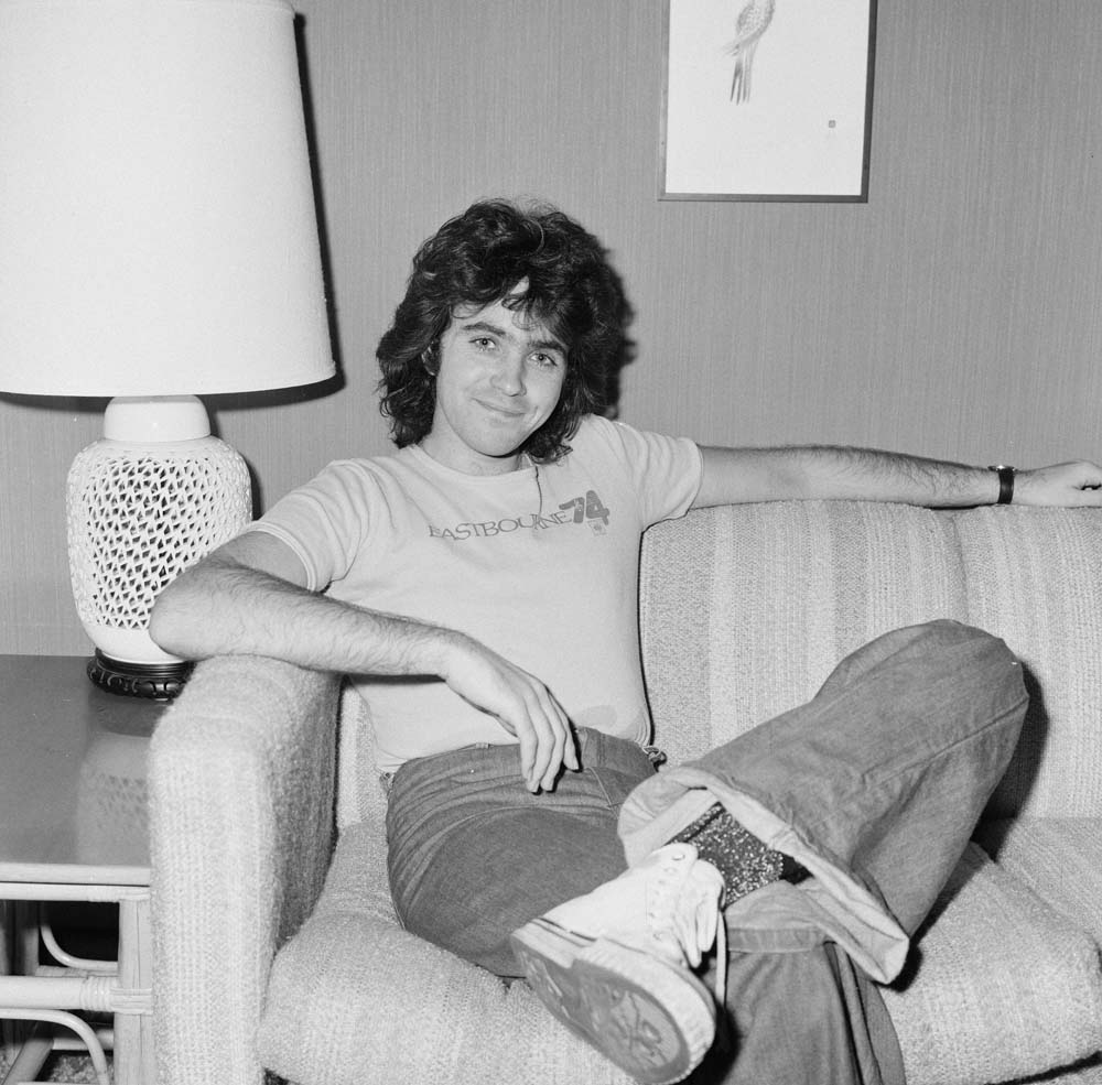 Singer David Essex relaxes in his Liverpool hotel room, November 1974