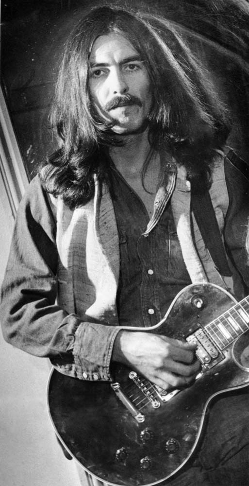 George Harrison, the first Beatle back at the Empire after the band's break-up, December 1969