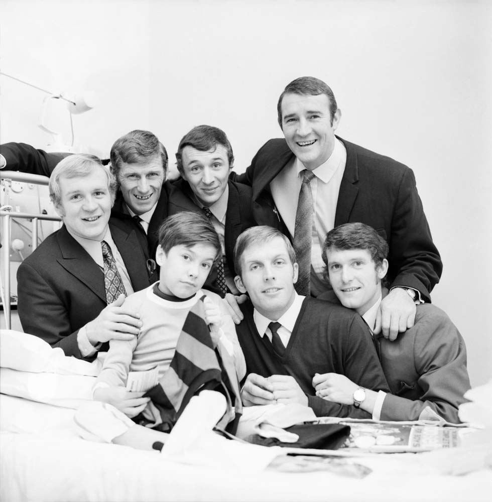 Skipper Tony Book and City team-mates visit a sick fan before playing West Ham, December 1969