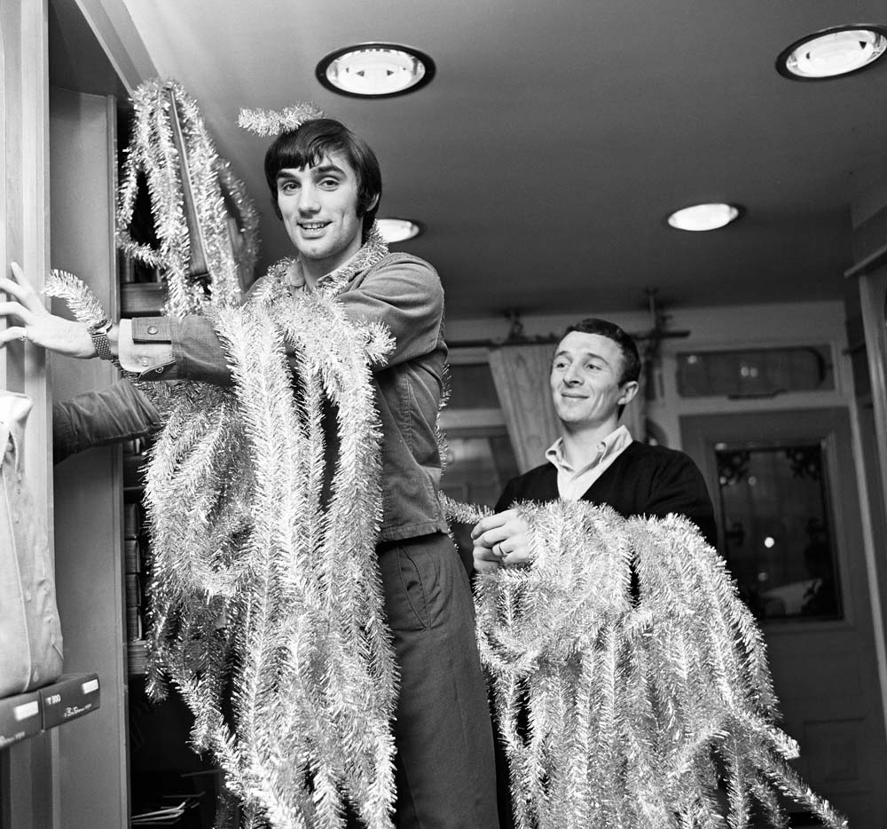 George Best and Mike Summerbee decorate their Manchester boutique, December 1967