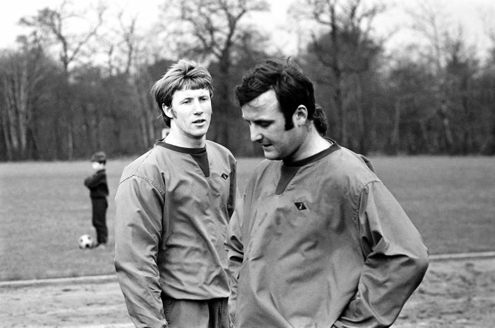 Colin Bell and Mike Doyle get down to some serious training on New Year's Eve 1969