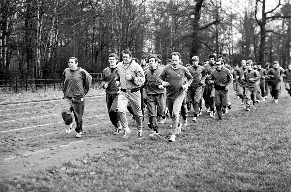 Manchester City players running laps at Wythenshawe Park, December 1969