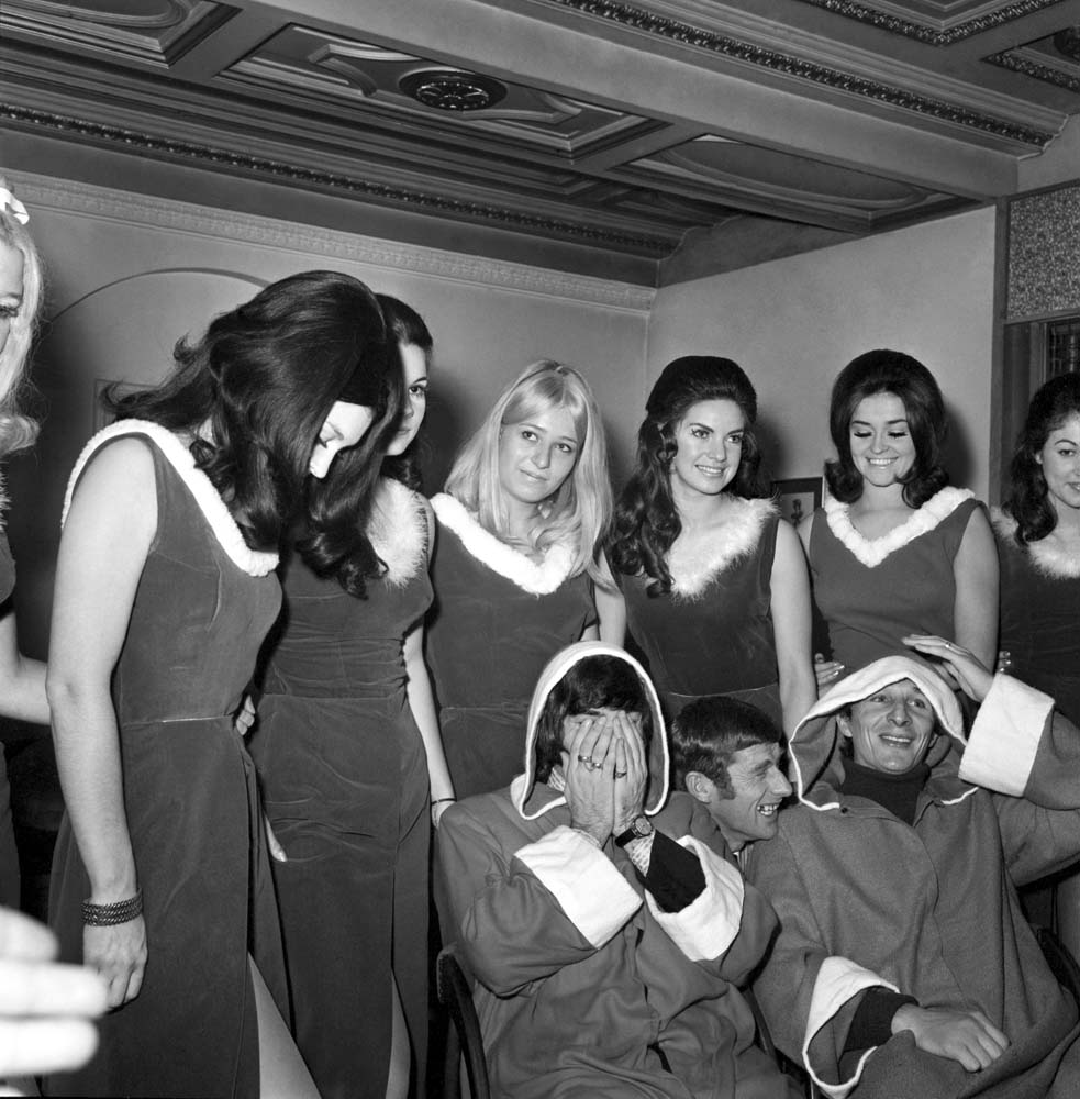 Mike Summerbee, right, and George Best try to play Santa as Tony Book interrupts, December 1969