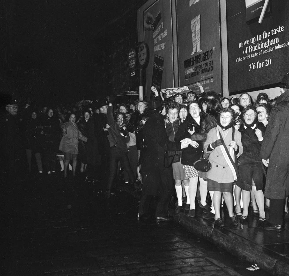 Fans queue outside the Liverpool Empire Theatre, December 1965