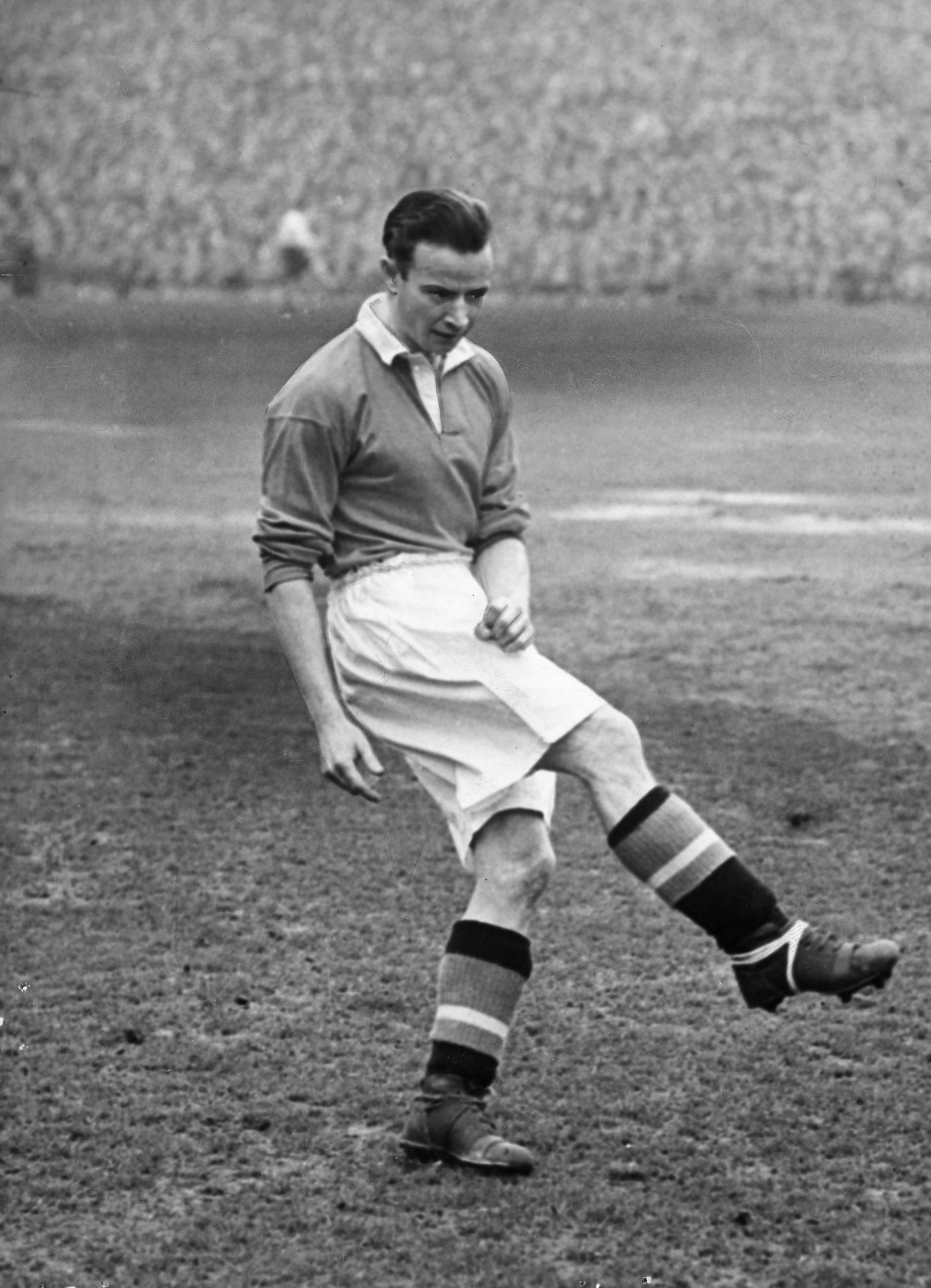 1952: Johnny Berry warms up before helping beat Liverpool 4-0 (pictured).