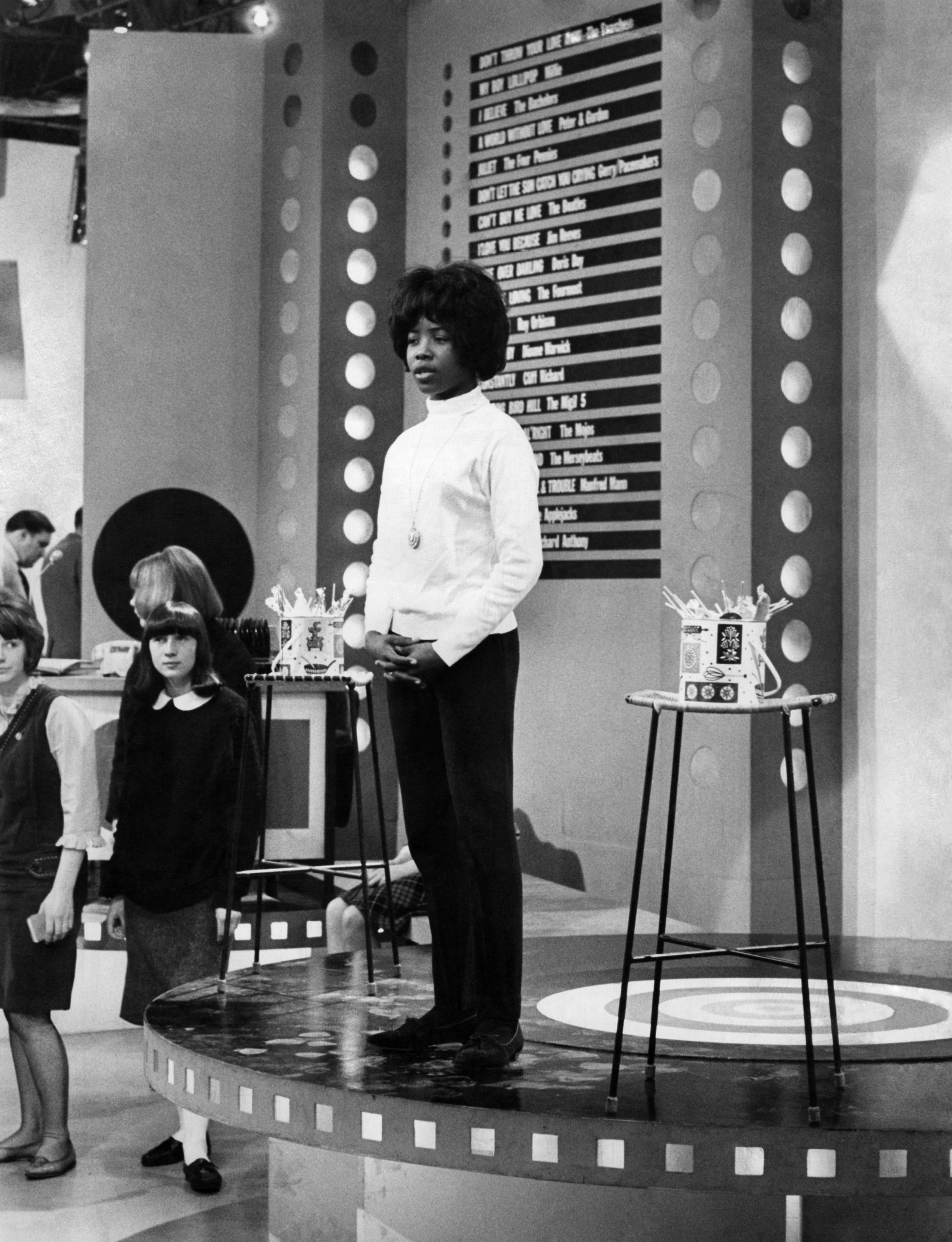 1964: Jamaican-born singer Millie Small rehearses her bluebeat hit My Boy Lollipop (pictured).