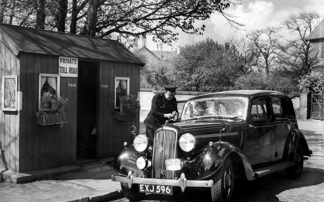 1950: A passing motorist pays a toll to enter the residential retreat of Victoria Park