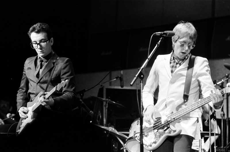 Elvis Costello, left, on stage with the Attractions, December 1979