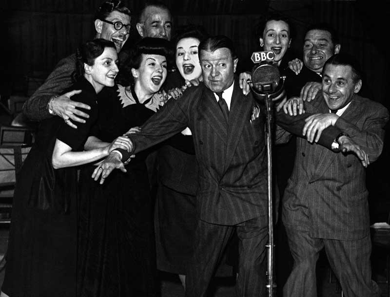 The ITMA cast, including Deryck Guyler and Hattie Jacques, with Tommy Handley, January 1947