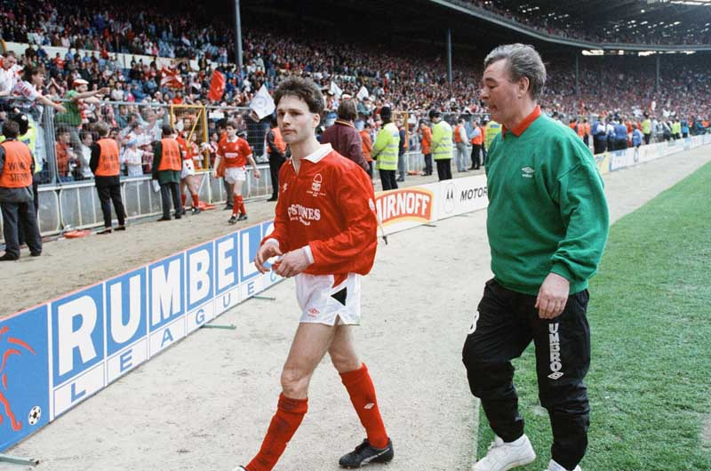Forest manager Brian Clough trudges off the Wembley pitch with Gary Crosby, April 1992