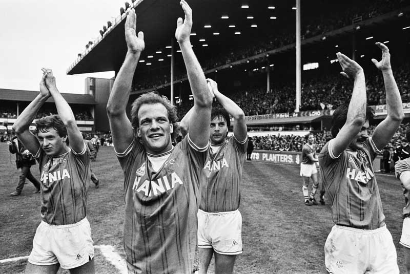 Kevin Sheedy, left, and Everton players Andy Gray, Graeme Sharp and Derek Mountfield after clinching the league title, May 1985