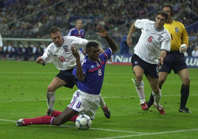 Nick Barmby, left, tussles with Marcel Desailly playing for England against France, September 2000