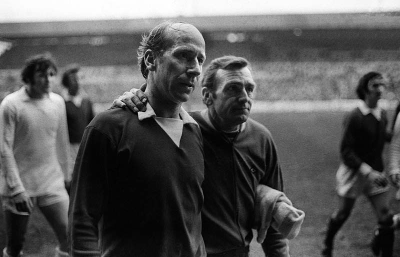 Leeds assistant coach Les Cocker consoles Bobby Charlton after United lost 5-1, February 1972