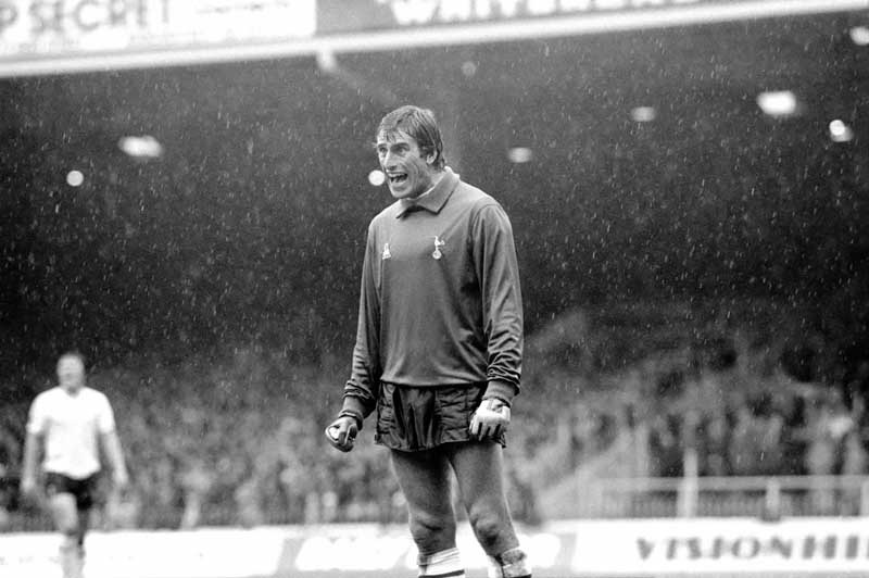 Rain-swept Ray Clemence shouts to defenders at Maine Road…
