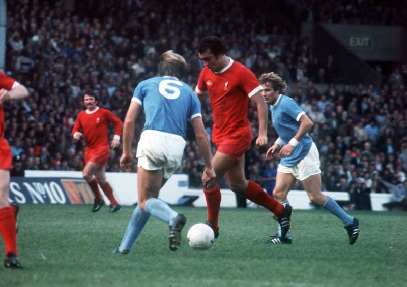 Liverpool's Ray Kennedy gives Manchester City's Colin Bell the slip….